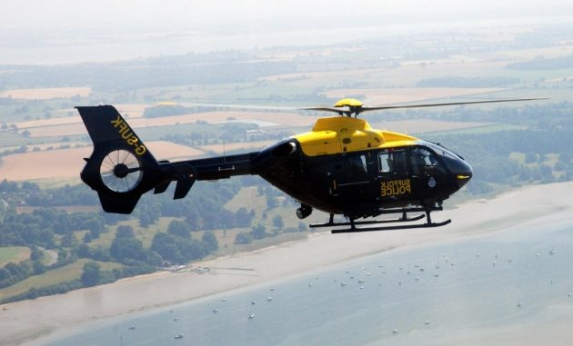 Police helicopter searching Purbeck coastline for missing